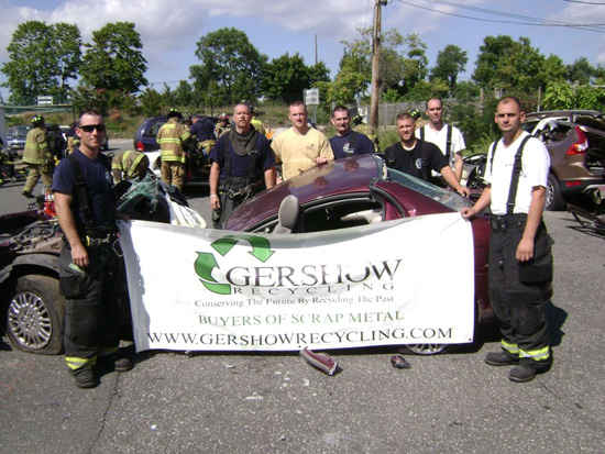 Members of the Brookhaven Fire Department pose with one of cars they used for extrication purposes. The vehicle was donated by Gershow Recycling.