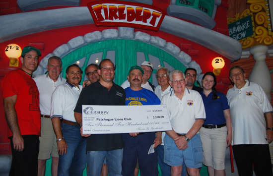 Patchogue Lions Club Hosts Christmas in June for Local School Children at Boomer's Family Fun Center