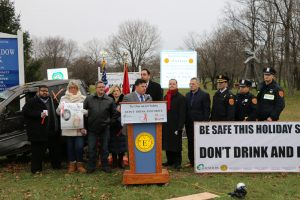 John Zaher (standing behind podium), Representative, Gershow Recycling, speaks during a press conference announcing the Town of Huntington's anti-drunk and distracted driving campaign on December 16.