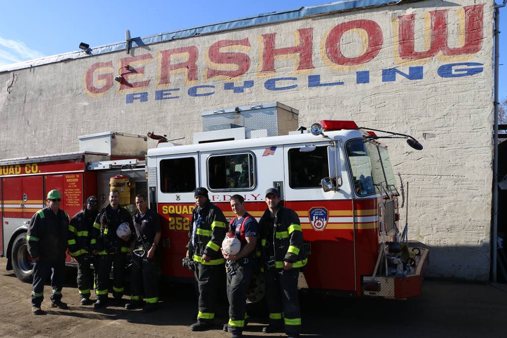 Eric Kugler (left), Manager, Gershow Recycling, presented turkeys to members of Fire Department of New York Rescue Squad 252.