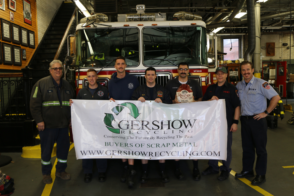 Eric Kugler (left), Manager, Gershow Recycling, presented turkeys to members of FDNY Engine 231/Ladder 120 at Watkins Avenue.