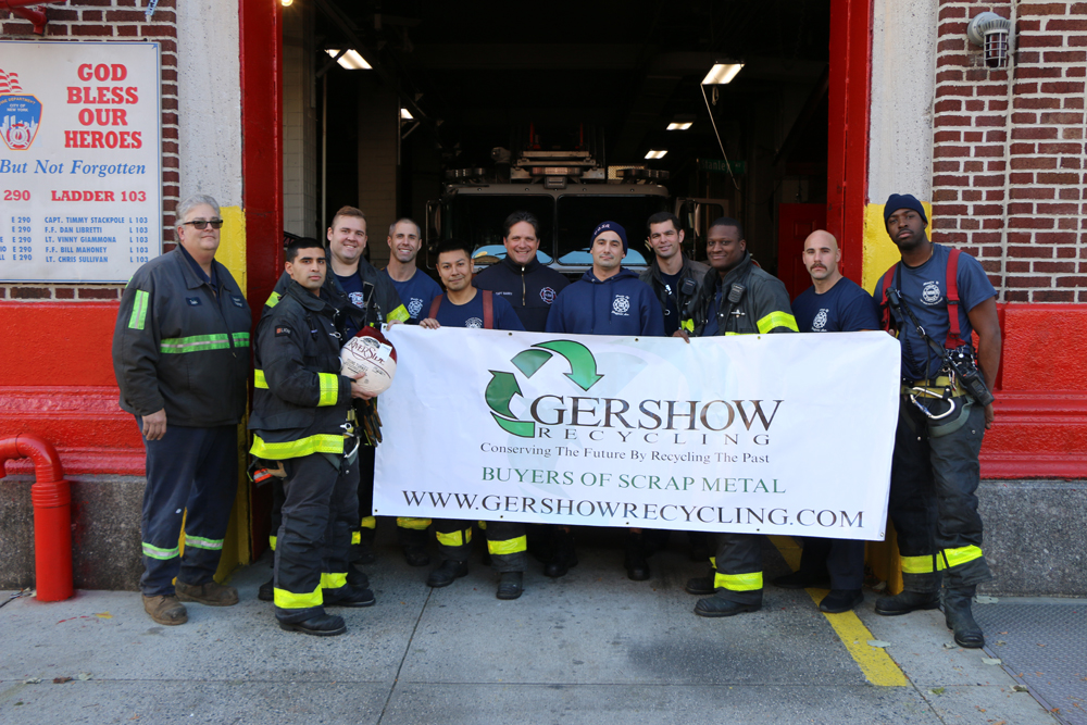 "Eric Kugler (left), Manager, Gershow Recycling, poses with members of Ladder 103 ""Pride of Sheffield Avenue"" and one of the turkeys the fire department received from Gershow."