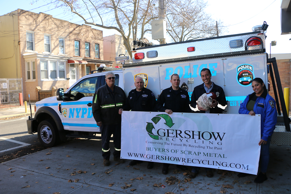 Eric Kugler (left), Manager, Gershow Recycling, poses with members of New York Police Department's Emergency Services Unit Truck #7 and the 75th Precinct and one of the turkeys donated by Gershow.