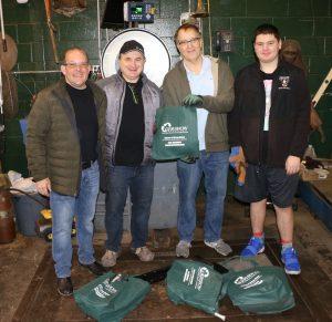 Gershow Manager Jonathan Abrams, Half Hollow Hills High School Robotics Team Coaches Yury Wolf-Sonkin and Michael Patrick and Team Member Dalton Asch.