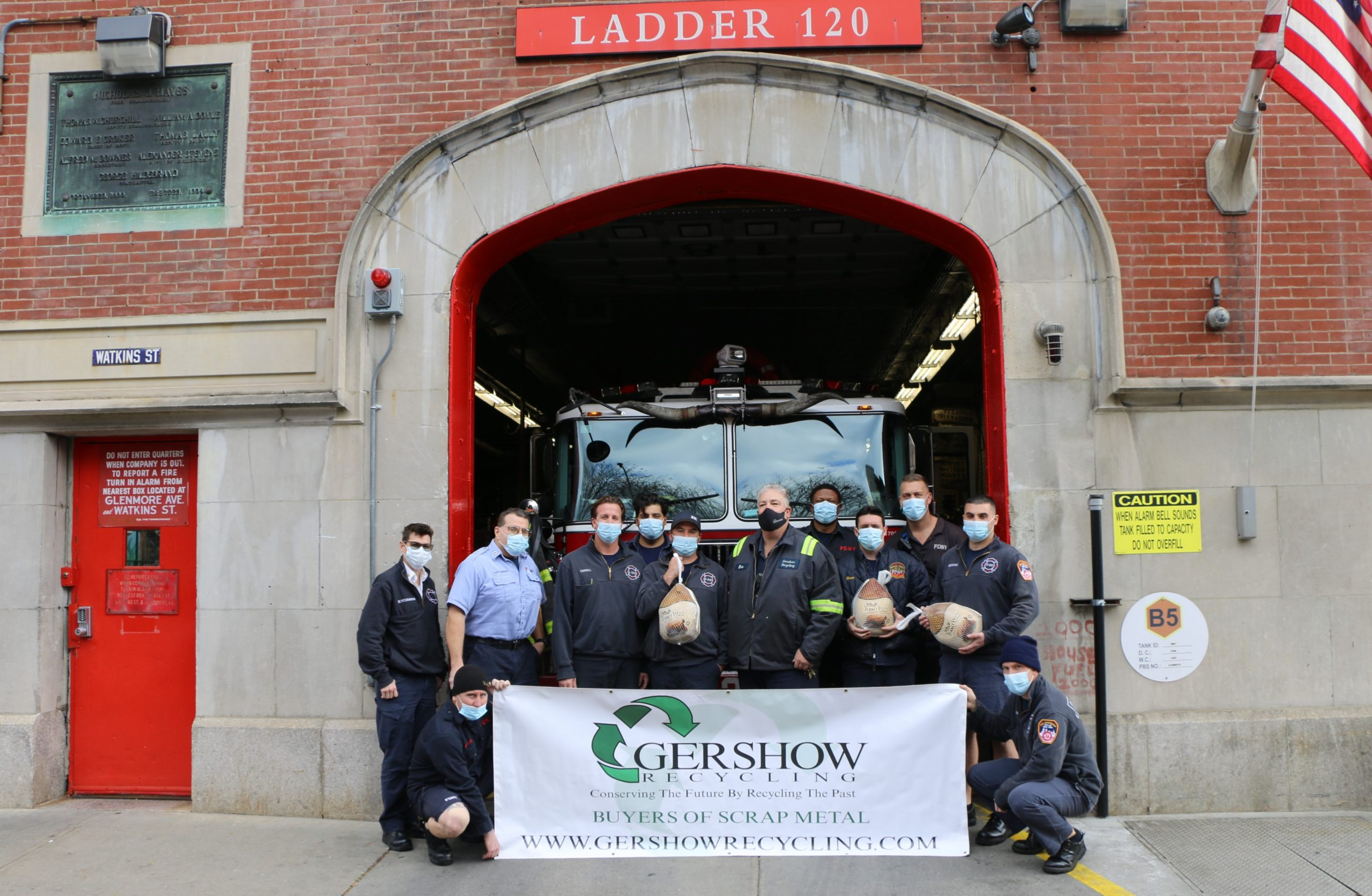 Eric Kugler (standing, fifth from right), Manager, Gershow Recycling, presented turkeys to members of FDNY's Engine 231/Ladder 120 at Watkins Street.