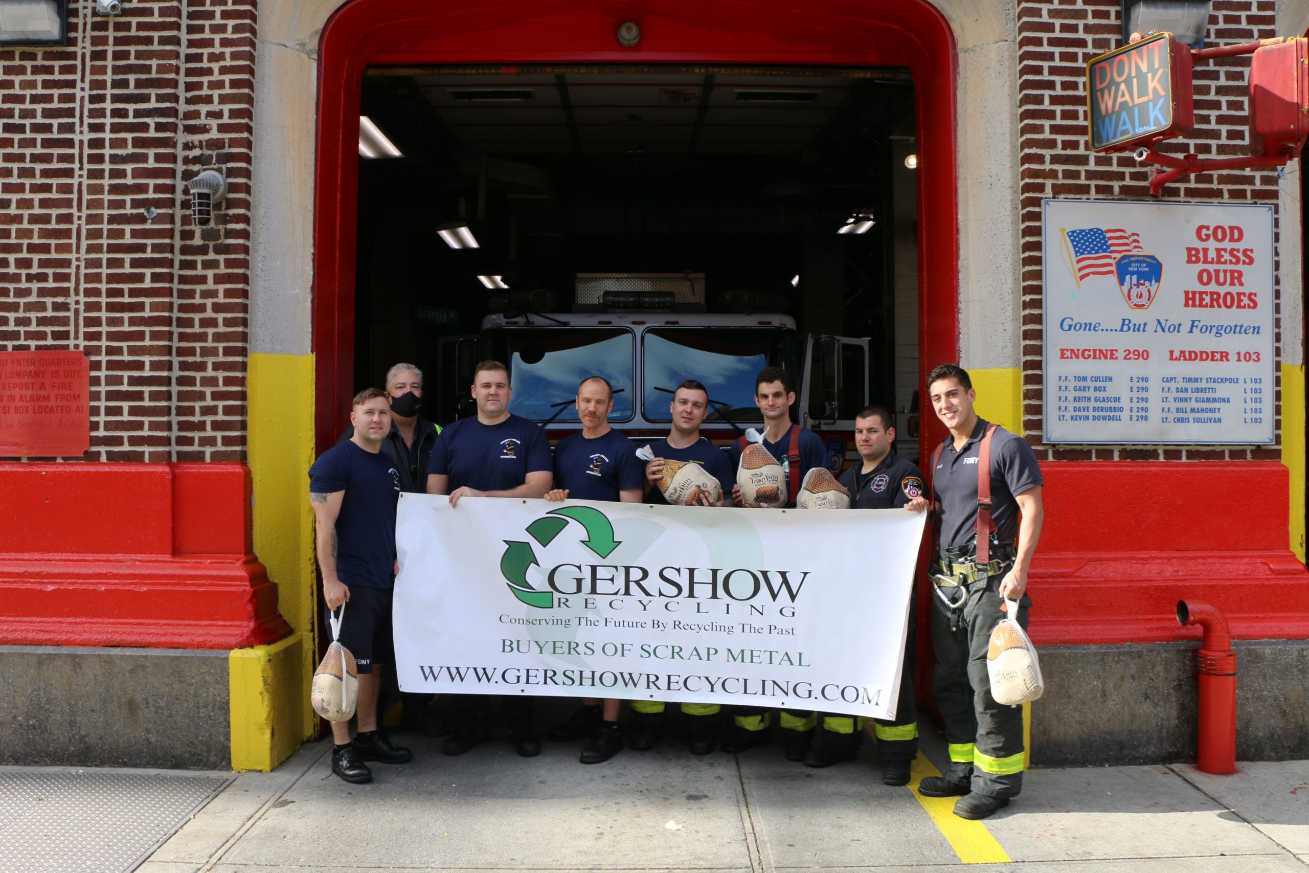"Eric Kugler (second from left), Manager, Gershow Recycling, presented turkeys to members of FDNY's Engine 290/Ladder 103 ""Pride of Sheffield Avenue."""