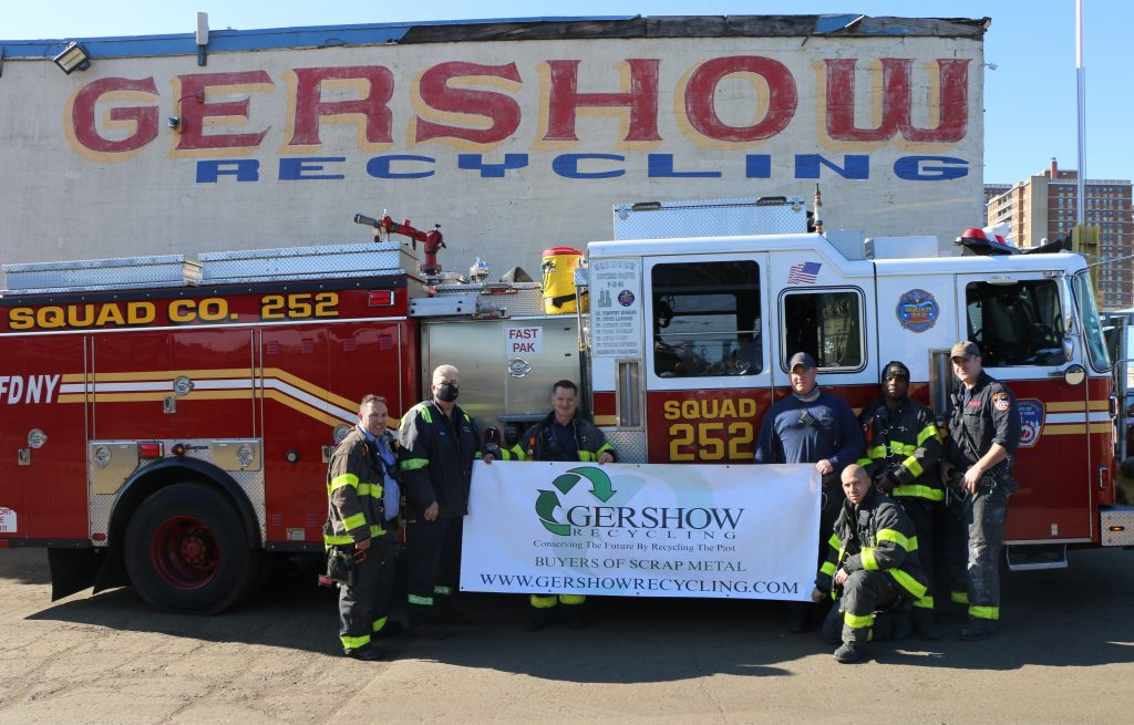 Eric Kugler (second from left), Manager, Gershow Recycling, presented turkeys to members of FDNY's Rescue Squad 252.