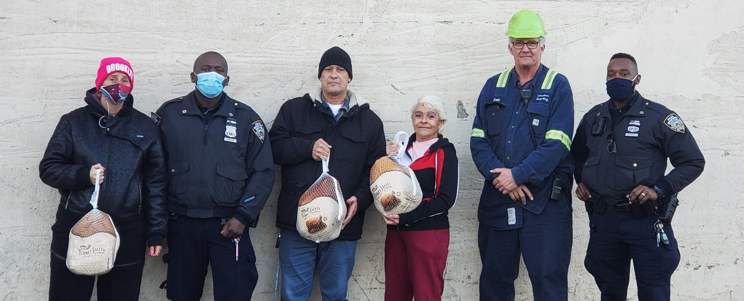 Scott Kolesari (second from right), Manager, Gershow Recycling, presented turkeys to members of NYPD's 73rd Precinct.